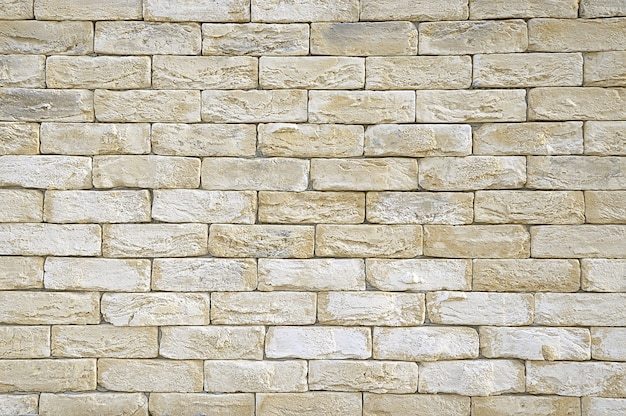 Old beige brick wall texture