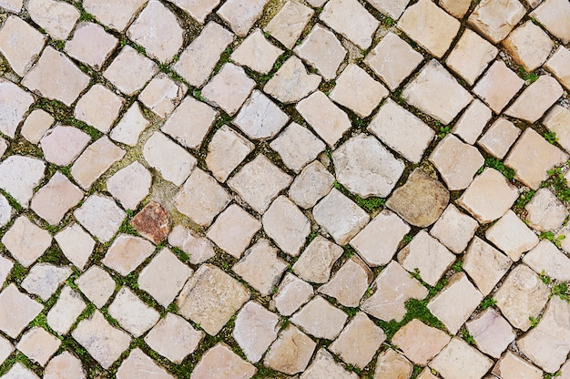 Old beige stone pavement background