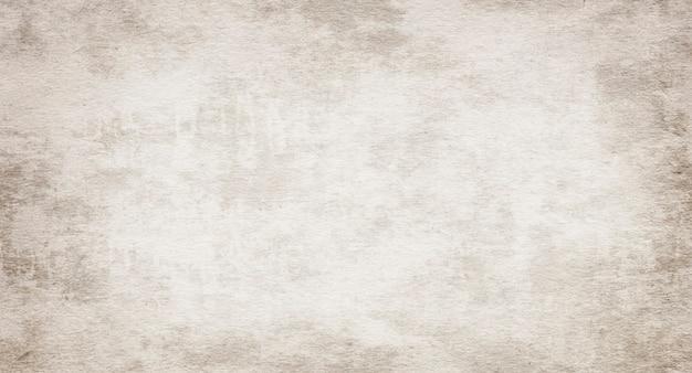 Старая бежевая винтажная текстура бумаги, изношенный гранж-фон в пятнах и полосах