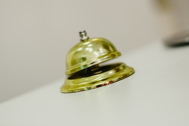 Old bell to call the bellman in a hotel, service bell hotel golden.