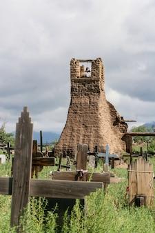 Old belltower from san geronimo chapel in taos pueblo, usa