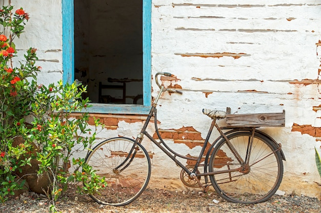 Old bicycle leaning against the wall