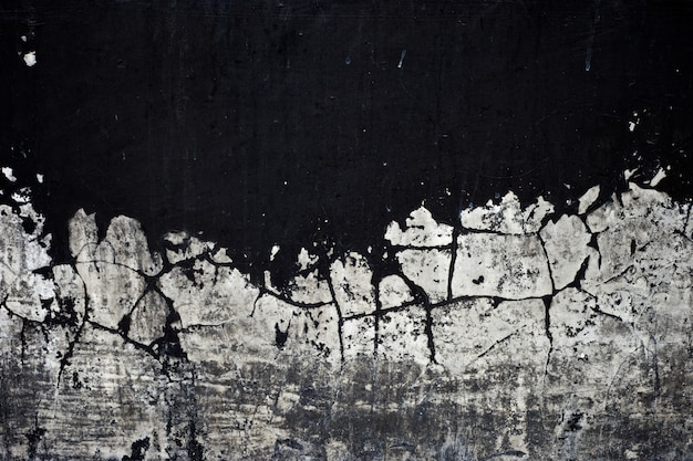 Old black paint texture peeling off concrete wall background