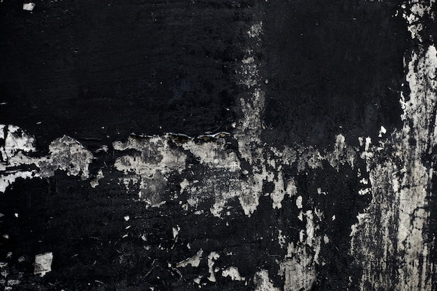 Old black paint texture peeling off concrete wall