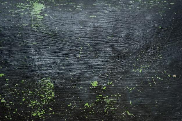 Старая черная пластиковая доска