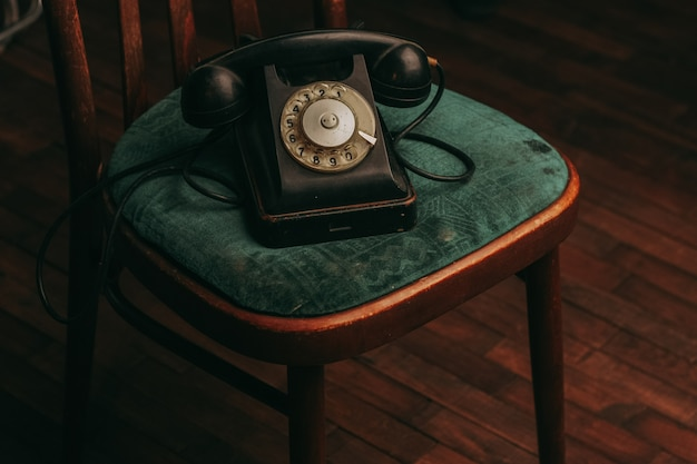 Old black telephone on the floor, vintage
