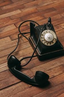 Old black telephone on the floor
