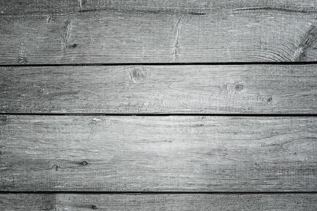 Старый пустой, текстурированный серый фон деревянной доски