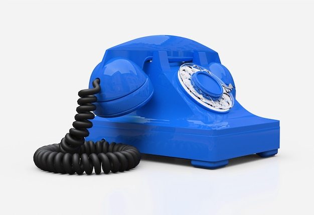 Old blue dial telephone on a white surface