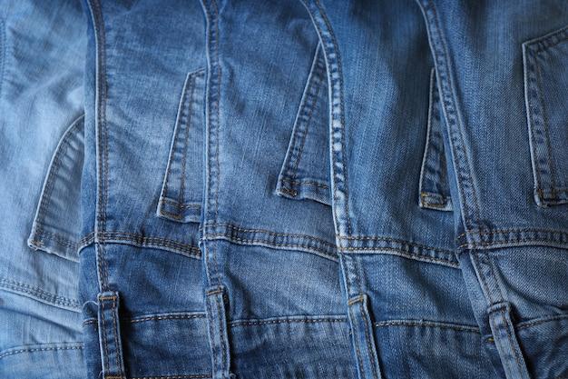 Old blue jeans texture or background denim