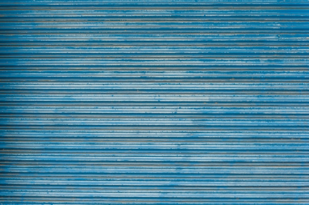 오래 된 파란 금속 시트 질감 벽지