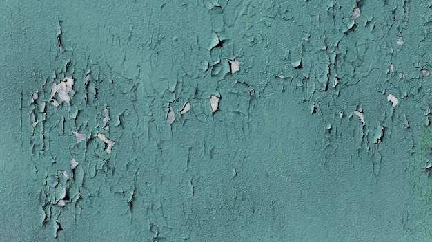 Old blue wall with fallen paint
