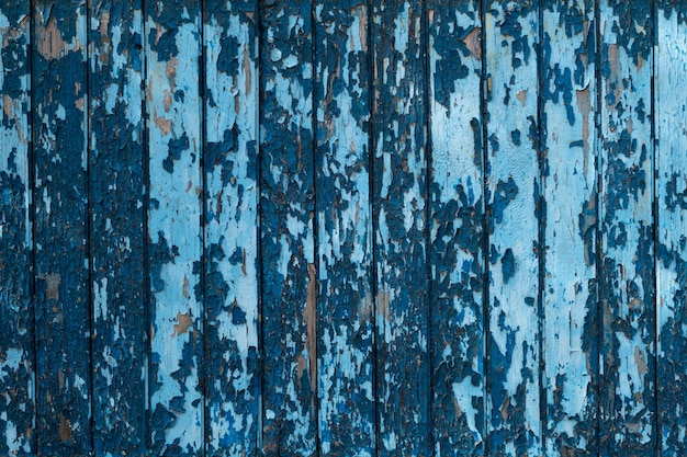 Old blue wooden fence texture background.