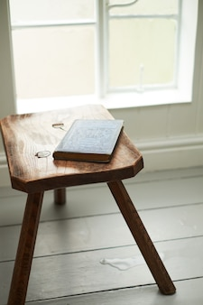 An old book is on the chair