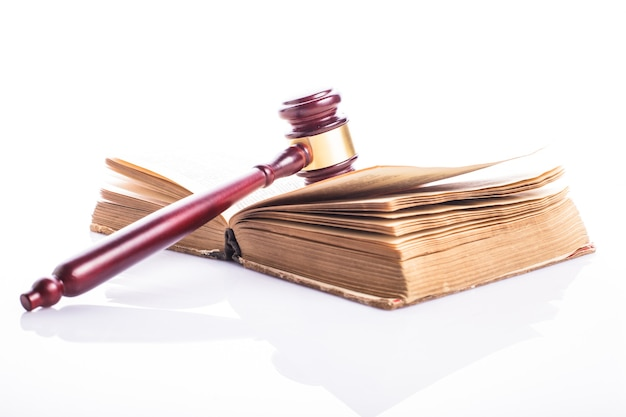 Old book and wooden gavel - jastice concept