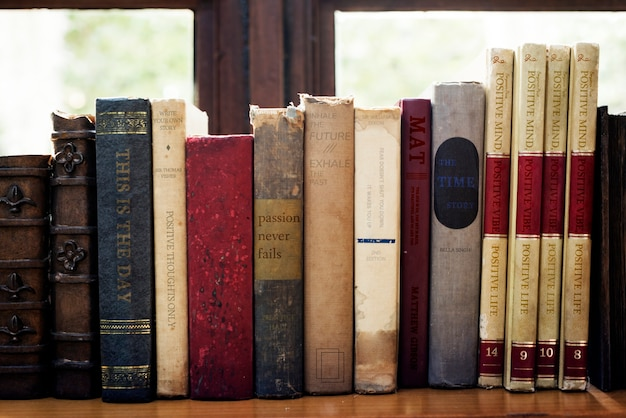 Old books arranged on the shelf