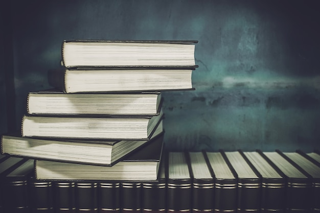 Old books on a bookshelf.