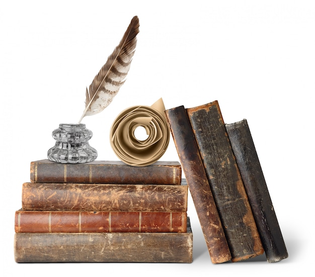 Old books, inkstand and scroll isolated