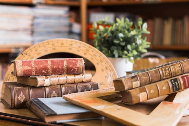 Old books near protractor and triangle