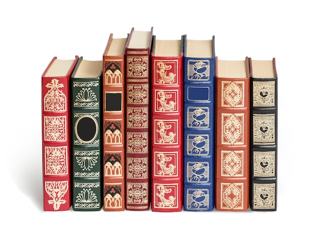Old books on white surface