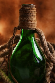 Old bottle and rope