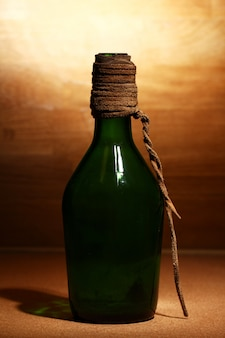 Old bottle over wooden surface