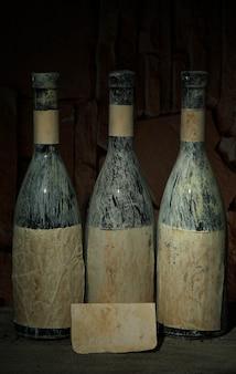 Old bottles of wine in old cellar, on dark