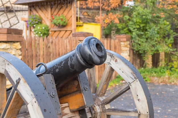 The old brass cannons in the battlefield.old metal cannons standing on two wooden supports on a