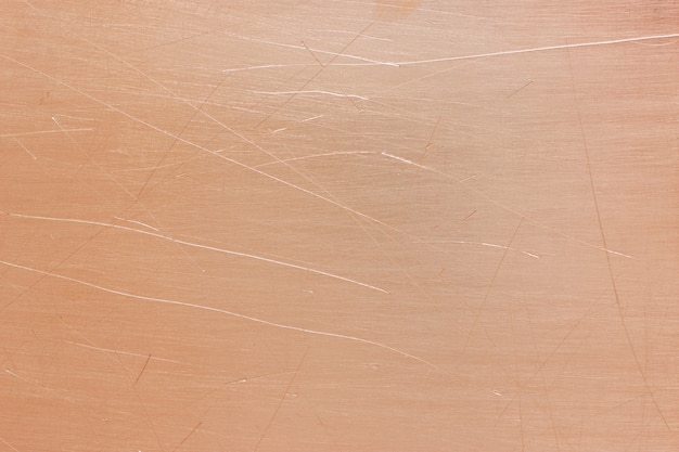 古い真鍮または銅の背景、ヴィンテージオレンジ色の金属板の質感