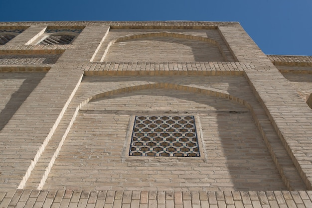 An old brick building with elements of arches ancient buildings of asia bukhara uzbekistan