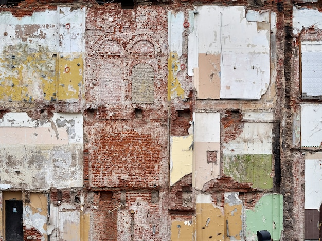Old brick color wall in demolition of a building texture background.