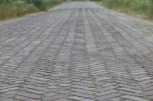 Old brick road close up