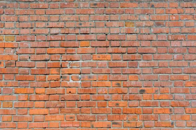 Старая кирпичная стена красного цвета, панорама кладки. предпосылка текстуры. крупный план.