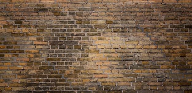 Старая предпосылка текстуры кирпичной стены.