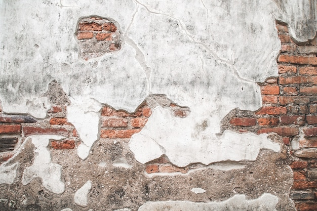 Old brick wall with cement texture background.