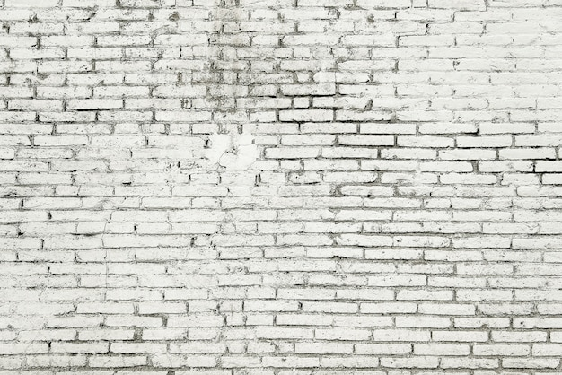 Old brick wall with white paint background texture