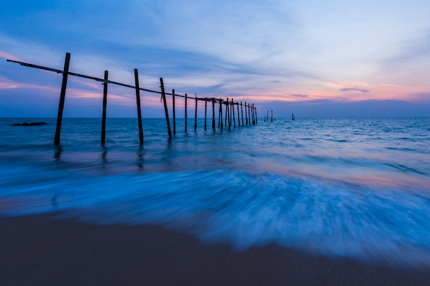 Old bridge and wave on the beach at phangnga thailand