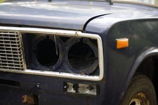 Old broken car headlight  driving