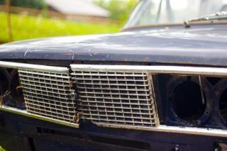 Old broken car headlight