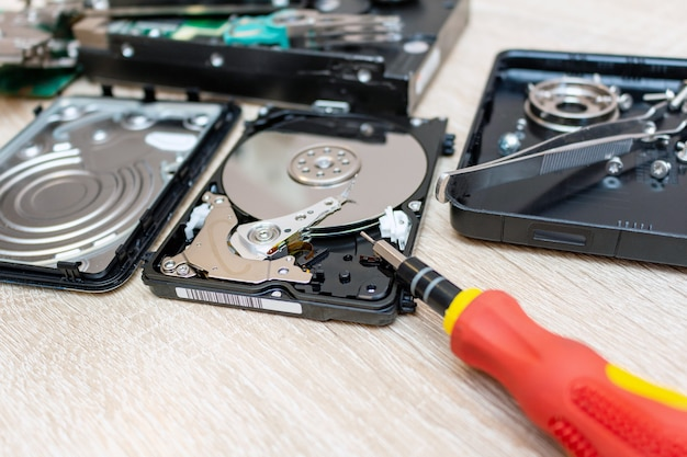 Old broken hard disk drives composition in a repair recovery service