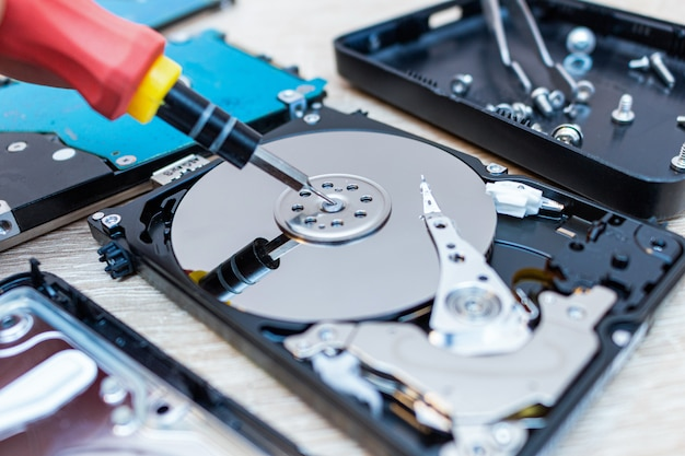 Old broken hard disk drives repair recovery in service close up