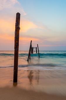 Old and broken wooden bridge at sea