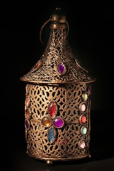 Old bronze arabic lamp isolated on black surface