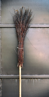 Old broom on wooden handle