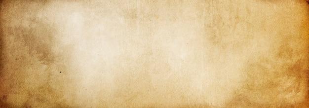 テキストとデザインのベージュのビンテージ紙の古い茶色の空白のグランジ背景