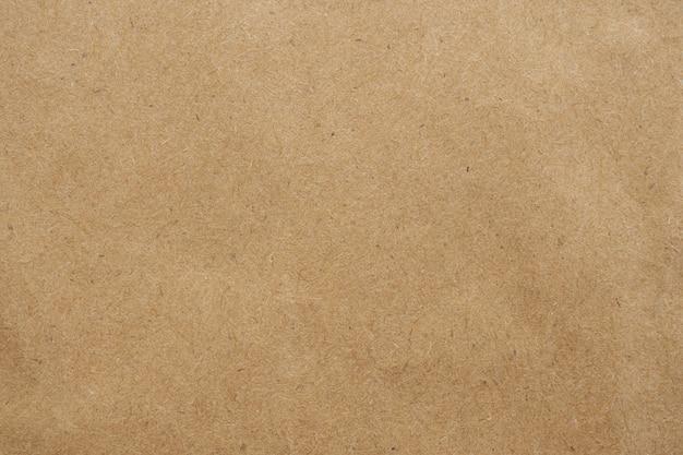 古い茶色のエコリサイクルクラフト紙テクスチャ段ボール
