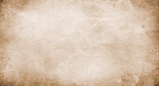 古い茶色のグランジの背景、デザインとテキストの場所の茶色のビンテージ紙のテクスチャ