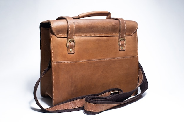 Old brown leather suitcase on white background bag for put the camera and other