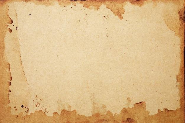 Старый гранж коричневой бумаги. абстрактная рамка жидкого кофе цвет текстуры.