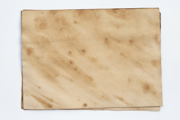 古い茶色の紙グランジ背景。抽象的な液体コーヒーの色の質感。